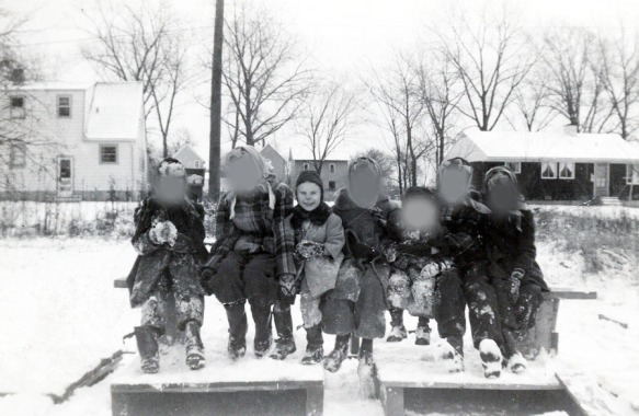 Seven girls dressed in winter clothes to endure a Chicago's winter.
