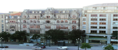 Downtown Porto. The old, wide building is abandoned - a common sight because there's little money for renovations.